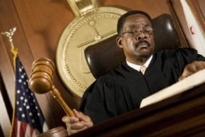 A judge holding a gavel in the courtroom